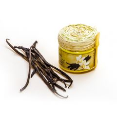 Face & body cream with vanilla in a glass jar.