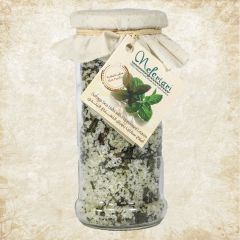 Safaga red sea salt with peppermint leaves in a glass jar.
