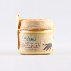 Face & body cream with vanilla in a glass jar.
